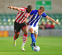 Lincoln City's John Akinde vies for possession with Sheffield Wednesday's Jordan Thorniley<br /> <br /> Photographer Chris Vaughan/CameraSport<br /> <br /> Football Pre-Season Friendly - Lincoln City v Sheffield Wednesday - Friday 13th July 2018 - Sincil Bank - Lincoln<br /> <br /> World Copyright &copy; 2018 CameraSport. All rights reserved. 43 Linden Ave. Countesthorpe. Leicester. England. LE8 5PG - Tel: +44 (0) 116 277 4147 - admin@camerasport.com - www.camerasport.com