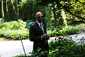 A Secret Service agent watches as the United States presidential motorcade departs following United States President Barack Obama's participation in a DNC roundtable at a private residence in Washington, DC on June 11, 2015. <br /> Credit: Aude Guerrucci / Pool via CNP