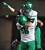 Farmingdale wide receiver No. 27 Steve Kunz gets hoisted into the air by No. 66 Joel Benitez after reeling in a pass for a 39-yard touchdown as time expired in the second quarter of the Nassau County varsity football Conference I final against Oceanside at Hofstra University on Saturday, Nov. 21, 2015.<br /> <br /> James Escher
