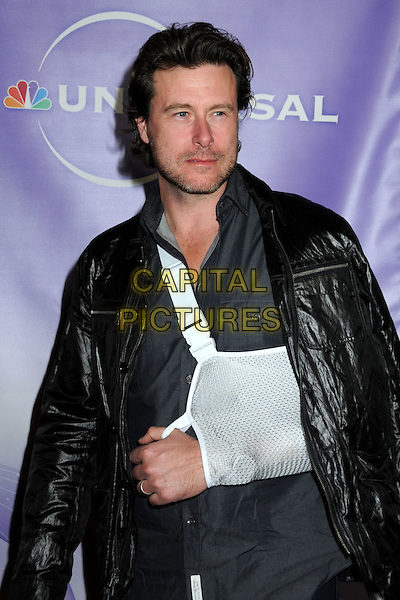 DEAN McDERMOTT .NBC Universal Press Tour Cocktail Party held at the Langham Hotel, Pasadena, California, USA, 10th January 2010..half length beard facial hair jacket arm in sling injury injured black leather  .CAP/ADM/BP.©Byron Purvis/AdMedia/Capital Pictures.