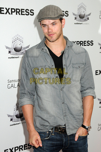"KELLAN LUTZ.Matt Leinart's 4th Annual ""Bowling With The Stars"" Event held at Lucky Strike Lanes, Hollywood, California, USA..July 15th, 2010.half length hands in pockets shirt grey gray flat cap hat stubble facial hair .CAP/ADM/BP.©Byron Purvis/AdMedia/Capital Pictures."