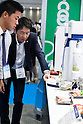 Visitors check the latest food machinery during the FOOMA Japan International Food Machinery and Technology Exhibition at Tokyo Big Sight on June 11, 2015, Tokyo, Japan. More than 200 companies showed off the latest technology for the food processing industry. The exhibition is held from June 9 to 12. (Photo by Rodrigo Reyes Marin/AFLO)