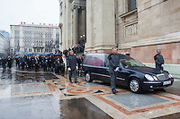 Mourners escort the coffin of late soccer player Jeno Buzanszky during his funeral in Budapest, Hungary on January 30, 2015. ATTILA VOLGYI
