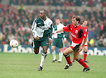 Michael Thomas of Liverpool and Ian Woan of Nottingham Forest - Premier League - Nottingham Forest v Liverpool - City Ground - Nottingham - England - 23rd March 1996 - Picture Simon Bellis/Sportimage