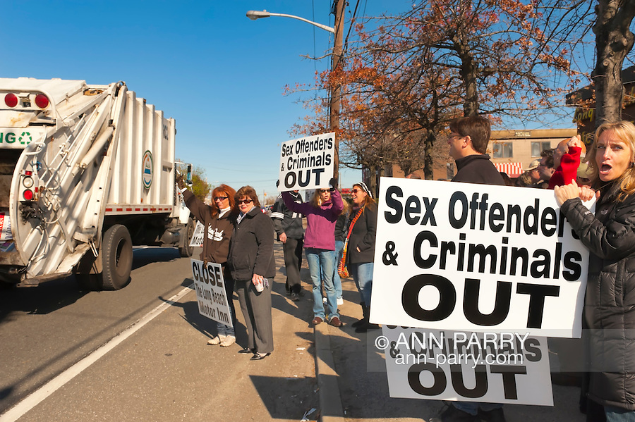 Island Park, New York, November 5, 2011: Protest Rally to close Long Beach Motor Inn. Residents and area business owners sharing information with passing traffic that residents include sex offenders and criminals, in rally held in front of the long Beach Motor Inn.