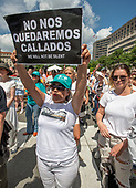 "A protestor holds a sign at the ""Women's March in Civil Disobedience to End Family Detention"" in Freedom Plaza in Washington, DC on Thursday, June 28, 2018.  <br /> Credit: Ron Sachs / CNP<br /> (RESTRICTION: NO New York or New Jersey Newspapers or newspapers within a 75 mile radius of New York City)"