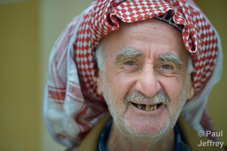 Yusef Gorges, a 66-year old internally displaced Christian, waits to see a physician during the visit of a mobile clinic to the village of Sharafiya, Iraq, which was flooded with displaced families when the Islamic State group took over nearby portions of the Nineveh Plains in 2014. The clinic is a program of the Christian Aid Program Nohadra - Iraq (CAPNI).