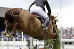 August 09, 2009: Philippe Le Jeune aboard Vigo D Arsouilles competing in the Grand Prix event. Longines International Grand Prix. Failte Ireland Horse Show. The RDS, Dublin, Ireland.