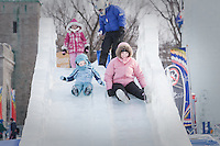 Margherita Miserandino and her daughter Caterina ride an ice slide at the Quebec Winter Carnival (Carnaval de Quebec) in Quebec city, February 3, 2010. With close to one million participants, it has grown to become the third largest winter celebration in the world.