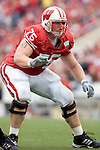 MADISON, WI - SEPTEMBER 9: Offensive lineman Andy Kemp #75 of the Wisconsin Badgers pass blocks against the Western Illinois Leathernecks at Camp Randall Stadium on September 9, 2006 in Madison, Wisconsin. The Badgers beat the Leathernecks 34-10. (Photo by David Stluka)