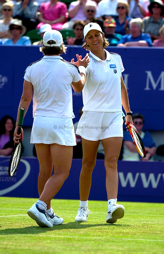 Photo. Rene Solari..23/6/01  .Eastbourne Day 6 - Finals.  Rennae Stubbs and Lisa Raymond celebrate as they clinch the doubles title beating Cara Black and Elena Likhovtseva 6-2 6-2.