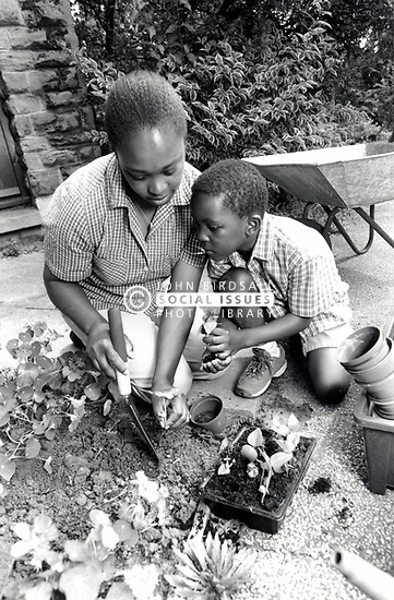 Mother and son gardening UK 1990s