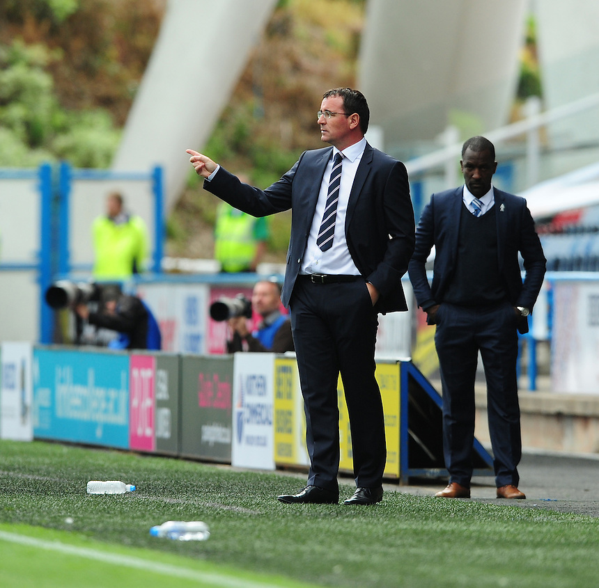 Blackburn Rovers manager Gary Bowyer shouts instructions to his team from the dug-out<br /> <br /> Photographer Chris Vaughan/CameraSport<br /> <br /> Football - The Football League Sky Bet Championship - Huddersfield Town v Blackburn Rovers - Saturday 15th August 2015 - The John Smith's Stadium - Huddersfield<br /> <br /> &copy; CameraSport - 43 Linden Ave. Countesthorpe. Leicester. England. LE8 5PG - Tel: +44 (0) 116 277 4147 - admin@camerasport.com - www.camerasport.com