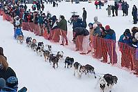 Musher # 52 Kim Darst at the Restart of the 2009 Iditarod in Willow Alaska
