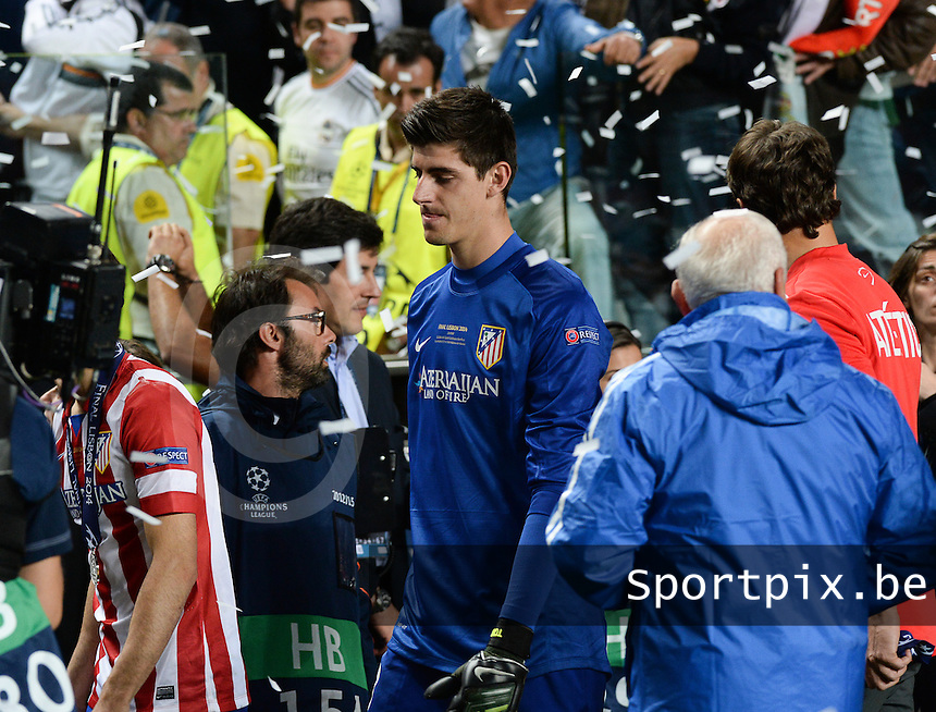 20140524 - LISBON , PORTUGAL : Atletico's goalkeeper Thibaut Courtois pictured disappointed after the lost soccer match between Real Madrid CF and Club Atletico de Madrid in the UEFA Champions League Final on Saturday 24 May 2014 in Estadio Da Luz in Lisbon .  PHOTO DAVID CATRY