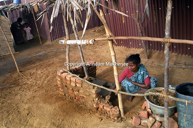 A woman extending her temporary shelter near Nagapattinam.India.