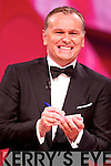 Presenter Dáithí Ó Sé thinks up a number during South Australia's Rose Sarah Doherty's magic card trick.