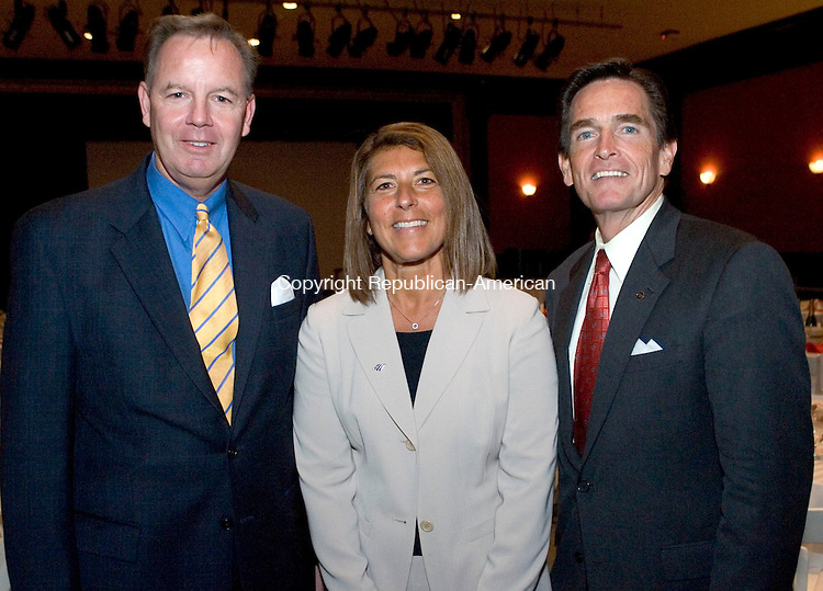 WATERBURY, CT- 05 SEPTEMBER 2008- 090508JT13-<br /> Bill Morris, partner at H. D. Segur, with Sandra Senich, from Bank of America, and Jim Smith, CEO of Webster Financial at a YMCA appreciation luncheon for the YMCA's 150th anniversary on Friday at the Mattatuck Museum Arts and History Center.<br /> Josalee Thrift / Republican-American