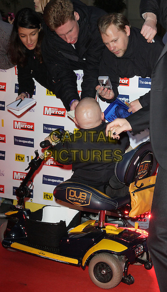 VERNE TROYER .The Pride of Britain Awards, Grosvenor House, Hotel, Park lane, London, England..October 5th, 2009.full length black suit back behind rear car fans crowd signing autographs tall short wheelchair .CAP/ROS.©Steve Ross/Capital Pictures.