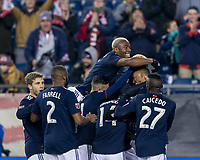 Foxborough, Massachusetts - April 6, 2018: First half action. In a Major League Soccer (MLS) match, New England Revolution (blue/white) vs Montreal Impact (white), at Gillette Stadium.<br /> Goal celebration.