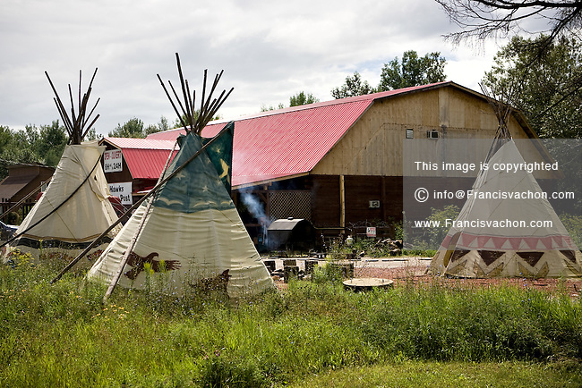 Tipis (also teepee, tepee) are pictured in a native camp in the Kitigan Zibi Algonquin Native reserve, just west of Maniwaki (Qc) July 29, 2008. Kitigan Zibi (also known as River Desert, and designated as Maniwaki 18 until 1994) is a First Nations Reserve of the Kitigan Zibi Anishinabeg First Nation, an Algonquin band.