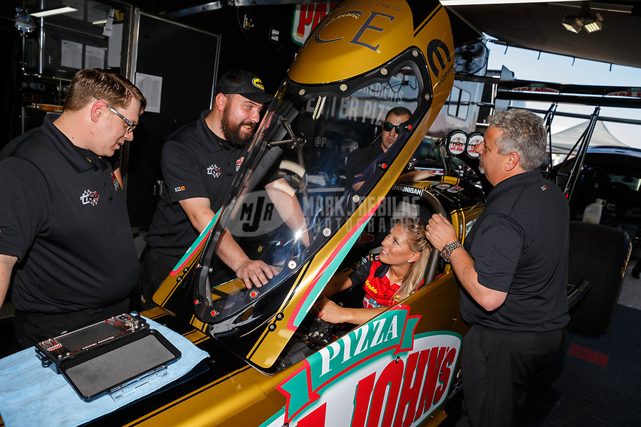 Apr 21, 2017; Baytown, TX, USA; NHRA top fuel driver Leah Pritchett with crew members during qualifying for the Springnationals at Royal Purple Raceway. Mandatory Credit: Mark J. Rebilas-USA TODAY Sports