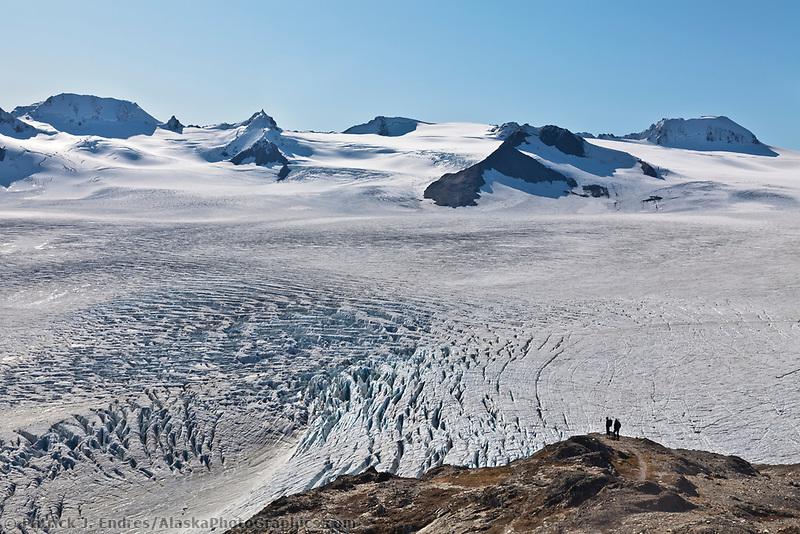 Hikers view the massive Harding Ice Field, Kenai Fjords National Park, Kenai mountains, Kenai Peninsula, southcentral, Alaska.
