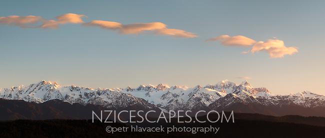 Southern Alps with its highest peaks of Aoraki, Mount Cook and Mount Tasman. Franz Josef Glacier on left, Westland Tai Poutini National Park, UNESCO World Heritage Area, West Coast, New Zealand, NZ