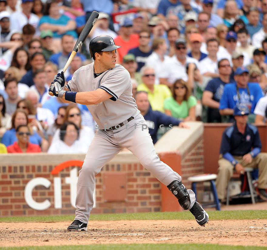 MARK TEIXEIRA, of the New York Yankees in action during the Yankees game against the Chicago Cubs on June 18, 2011 at Wrigley Field in Chicago, Illinois. The Yankees beat the Cubs 4-3.