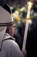 Pope Francis, holds a candle during the Easter vigil mass in Saint Peter's Basilica, in the Vatican.,30 March 2013