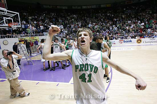 Provo's Chris Collinsworth celebrates the championship. Ogden - Provo vs. Payson High School boys basketball, 4A State Basketball Championship Game at the Dee Events Center Wednesday.