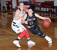 RICK PECK/SPECIAL TO MCDONALD COUNTY PRESS McDonald County's Ragan Wilson drives past an Aurora defender during the Lady Houns' 33-29 win on Feb. 2 in the third place game of the Seneca Girls' Basketball Tournament.