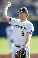 Michigan Wolverines first baseman Danny Zimmerman (6) warms up before the NCAA baseball game against the Rutgers Scarlet Knights on April 26, 2019 at Ray Fisher Stadium in Ann Arbor, Michigan. Michigan defeated Rutgers 8-3. (Andrew Woolley/Four Seam Images)
