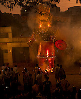 Ram Leela - the story of Lord Ram is performed as a street play during the week preceding the anniversary of his triumph over Ravan on Dassera day.  This folk performance is popular among North Indian Hindus. Seen here is the final act of the Ram Leela which ends with the burning of Ravan's effigy. Location - Khar, Mumbai. The Raavan effigy stuffed with straw and firecrackers  is set ablaze.