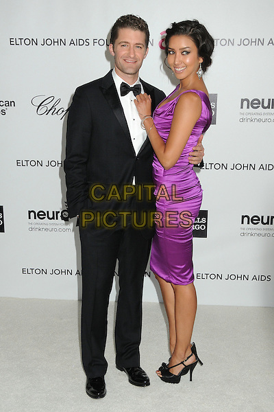 Matthew Morrison & Renee Puente.20th Annual Elton John Academy Awards Viewing Party held at West Hollywood Park, West Hollywood, California, USA..February 26th, 2012.full length tuxedo purple dress couple black white bow tie side .CAP/ADM/BP.©Byron Purvis/AdMedia/Capital Pictures.