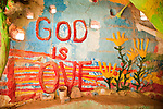 Inside the museum of Leonard Knight's Salvation Mountain, near Niland, Calif. God is Love.