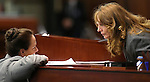 Nevada Assembly Speaker Marilyn Kirkpatrick, D-North Las Vegas, right, talks with Assembly Chief Clerk Susan Furlong during the Assembly floor session at the Legislative Building in Carson City, Nev., on Tuesday, Feb. 26, 2013..Photo by Cathleen Allison