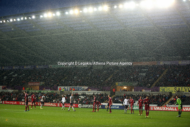 Pictured: Pouring rain during the second half. Monday 19 May 2014<br /> Re: UEFA Euro Under-21 Qualifier, Wales v England at the Liberty Stadium, Swansea, south Wales, United Kingdom