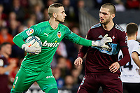 1st February 2020; Mestalla, Valencia, Spain; La Liga Football,Valencia versus Celta Vigo; Goalkeeper Jaume Domenech of Valencia CF pushes Okay Yokuslu of Celta away so that he can clear the ball