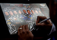 Jul. 27, 2013; Sonoma, CA, USA: Detailed view as NHRA top fuel driver Antron Brown signs an autograph during qualifying for the Sonoma Nationals at Sonoma Raceway. Mandatory Credit: Mark J. Rebilas-