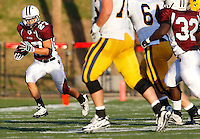 Kyle Sakowski #27 of Don Bosco runs around St Ignatius defenders after intercepting a pass near the endzone during the game at Harding Stadium in Steubenville, OH on September 25, 2010. ..Jared Wickerham.