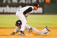 Shortstop Marcus Semien #6 of the Kannapolis Intimidators tags out Michael Rooney #31 of the Delmarva Shorebirds as he tries to steal second base at Fieldcrest Cannon Stadium on August 6, 2011 in Kannapolis, North Carolina.   (Brian Westerholt / Four Seam Images)