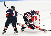 Casey Knajdek (UConn - 5), Rebecca Hewett (UConn - 18), Kayla Tutino (BU - 8) - The Boston University Terriers defeated the visiting University of Connecticut Huskies 4-2 on Saturday, November 19, 2011, at Walter Brown Arena in Boston, Massachusetts.