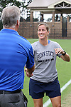 07 September 2014: Penn State head coach Erica Walsh (right) shakes hands with Duke head coach Robbie Church (left) before the game. The Duke University Blue Devils hosted the Penn State University Nittany Lions at Koskinen Stadium in Durham, North Carolina in a 2014 NCAA Division I Women's Soccer match. PSU won the game 4-3.