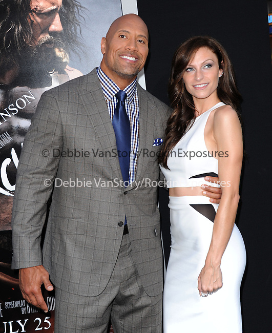 Dwayne Johnson and girlfriend attends The Paramount Pictures L.A. Premiere of Hercules held at The TCL Chinese Theatre in Hollywood, California on July 23,2014                                                                               © 2014 Hollywood Press Agency
