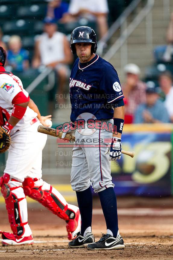 Ryan Eigsti (18) of the Northwest Arkansas Naturals spits between at bats during a game against the Springfield Cardinals at Hammons Field on July 31, 2011 in Springfield, Missouri. Northwest Arkansas defeated Springfield 9-1. (David Welker / Four Seam Images)