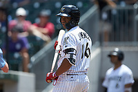 Eloy Jimenez (16) of the Charlotte Knights checks with the third base coach for the signs during the game against the Indianapolis Indians at BB&T BallPark on August 22, 2018 in Charlotte, North Carolina.  The Indians defeated the Knights 6-4 in 11 innings.  (Brian Westerholt/Four Seam Images)