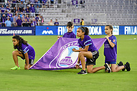 Orlando, FL - Saturday March 24, 2018: Flag kids display the Orlando Pride flag prior to a regular season National Women's Soccer League (NWSL) match between the Orlando Pride and the Utah Royals FC at Orlando City Stadium. The game ended in a 1-1 draw.