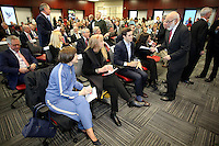 NWA Democrat-Gazette/DAVID GOTTSCHALK   John Tyson (right), chairman of the board for Tyson Foods, speaks with family members Thursday, February 9, 2017, during a dedication ceremony for Springdale's new Don Tyson School of Innovation campus. The school is named after Donald Tyson former chairman and chief executive officer of Tyson Foods. Half of the campus opened in August, with construction wrapping up on the other half in time for this semester.