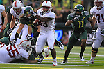 10/02/10-- Stanford running back Stepfan Taylor evades Oregon defenders for touchdown in the first half at Autzen Stadium in Eugene, Or,.Photo by Jaime Valdez......
